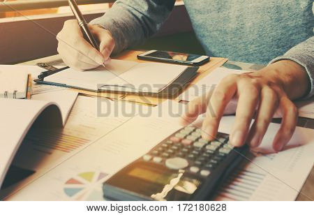 Calculator With Hand Man Doing Finance And Calculate On Desk About Cost At Home Office.