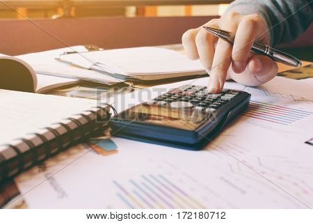 Calculator With Hand Woman Calculate About Cost In Home Office.