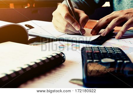 Finance Concept. Man Writing And Make Note About Cost And Expenses At Home Office.
