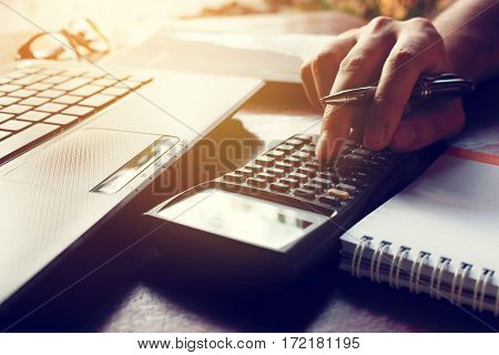 Calculator With Hand Man Calculate Finance On Desk At Home Office.