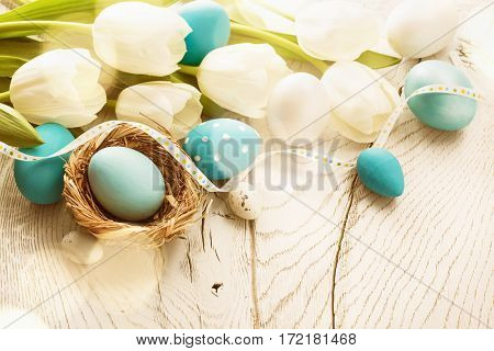Spring composition with flowers and Easter eggs
