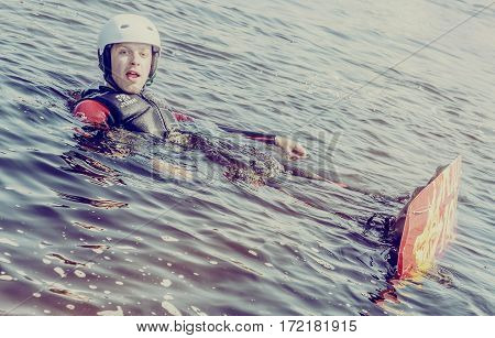 Minsk, Belarus - on July 13, 2013: a trip on the river Pripyat. Occupations extreme sports Wakeboarding.