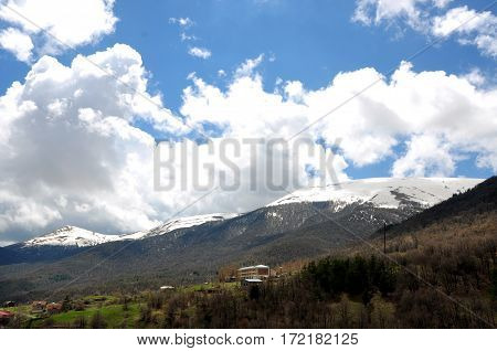 Lovely view of the mountains. Nice winter mountain landscape. Snow lies on the surface of the mountains. Caucasus Mountains. Mountain forest clouds landscape.