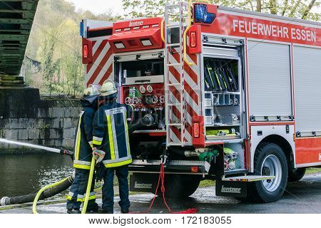 ESSEN KETTWIG NRW GERMANY - APRIL 28 2016: Fire fighter trainer use in Essen Kettwig Germany. Firefighters in Uniform during training.