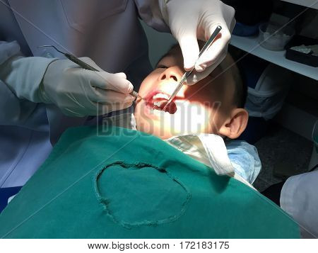 Kid having mouth checkup in dental clinic