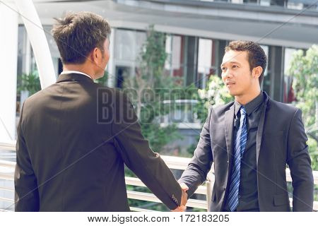 Two Businessmen are shaking hands, success man