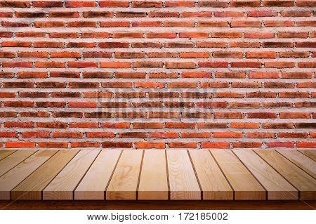 Empty wooden table with red brick wall background. For display or montage your products.
