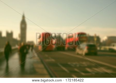 blurred background of traffic on Westminster bridge, famous black cabs and red doubledeckers, London, UK