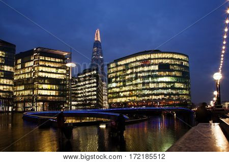 night cityscape of London with office buildings