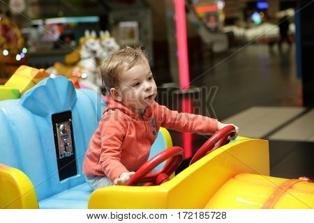 Boy Driving Toy Car