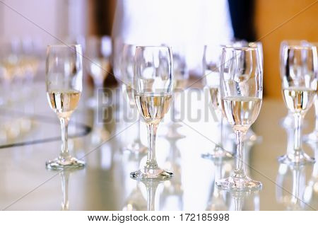 Glasses of champagne on the table with shallow depth of field