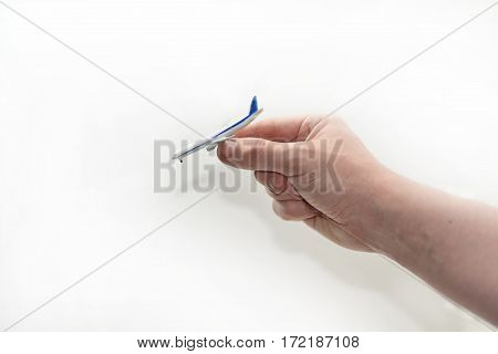 Small aircraft in mans hand. Isolated on white background.