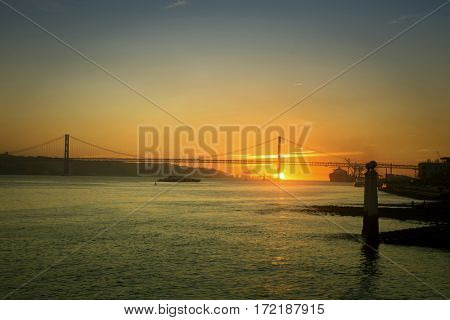 Beautiful sunset on the 25 de Abril Bridge over the Tagus river in Lisbon