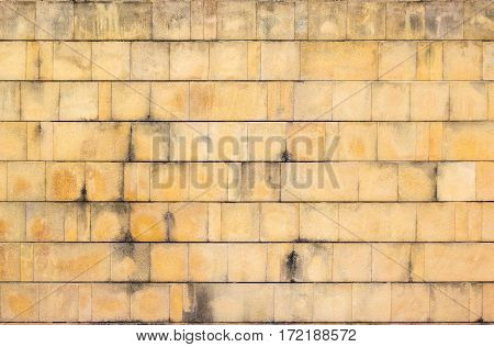 backdrop and texture of old stone wall surface.