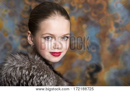 Kids Makeup Dancer. Portrait of a charming little girl on studio wall background