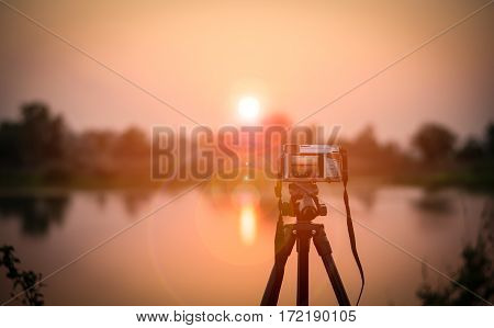 Camera And Sunset
