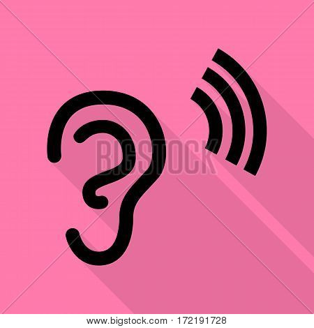 Human ear sign. Black icon with flat style shadow path on pink background.