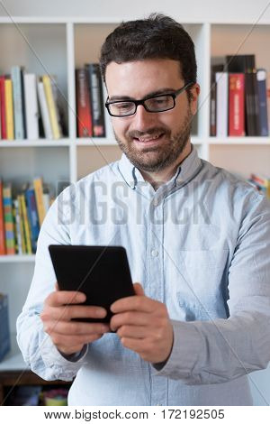 Man Holding An E-book Reader In Hands