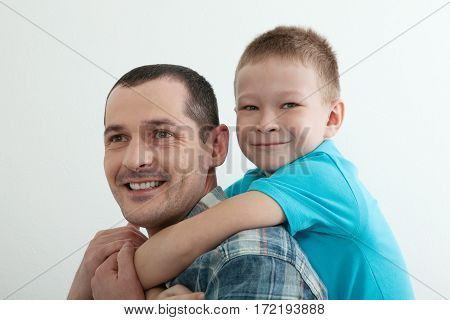Happy father and son playing and laughing together at home. Family concept
