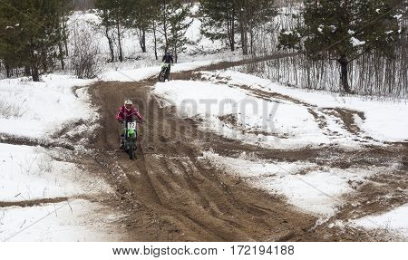 KYIV UKRAINE - FEBRUARY 15 2015: Motorcyclists training on a winter race track.