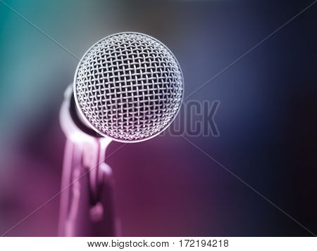 Color filter/ Close up of microphone in karaoke room or conference room. With place your text on background