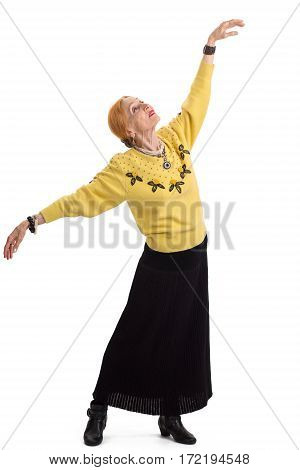 Senior woman dancing. Isolated lady with outstretched arms. Flight of the soul.