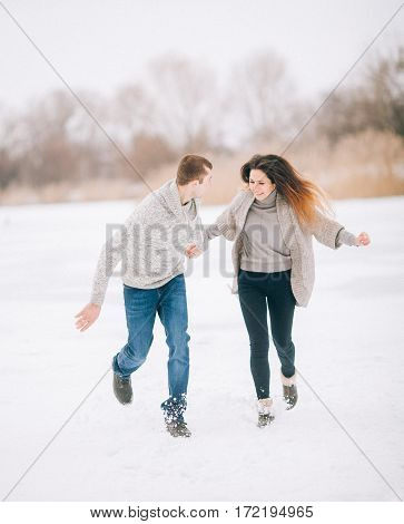 Young Woman And Man On Winter Walk.