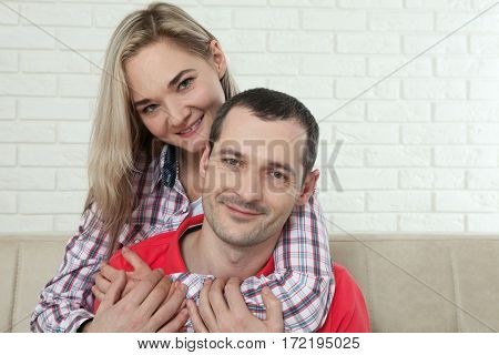 Happy young couple smiling. Man and woman hugging isolated.