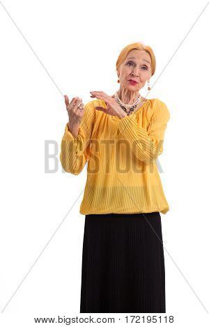 Senior woman talking isolated. Lady standing on white background. Self confidence tips.