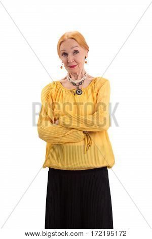 Old woman with crossed arms. Confident lady on white background. Stay true to your principles.