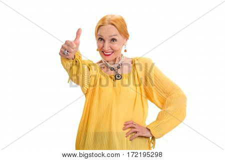 Senior woman showing thumbs up. Lady smiling on white background. Change your mindset.