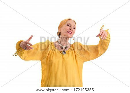 Elderly woman smiling. Cheerful lady on white background. How to become happy.
