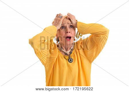 Desperate woman holding her head. Upset senior lady isolated. Lose everything in an eyeblink.
