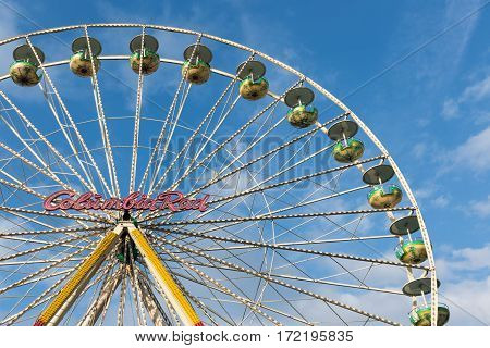 DUISBURG GERMANY - DECEMBER 17 2016: Ferris wheel against a blue sky at the Christmas fair in Duisburg Germany