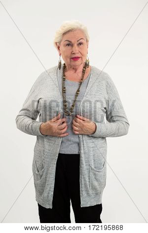 Isolated senior woman standing. Old lady on white background. Older women fashion.