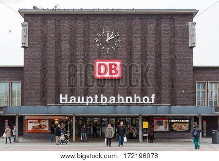 DUISBURG GERMANY - DECEMBER 17 2016: Unknown people entering and leaving the main station of Duisburg in Germany