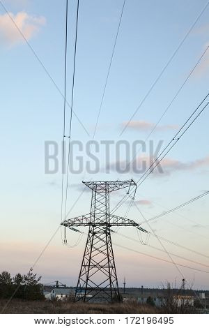 Electricity pylon and power lines against the sky.
