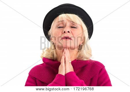 Old lady praying isolated. Senior female with closed eyes.