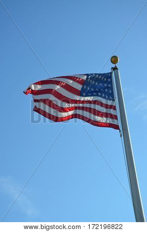 United states flag in the breeze on a clear day.