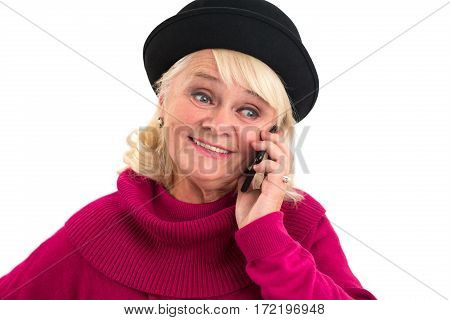 Old woman with cellphone smiling. Happy lady on white background. Choose the best mobile operator.