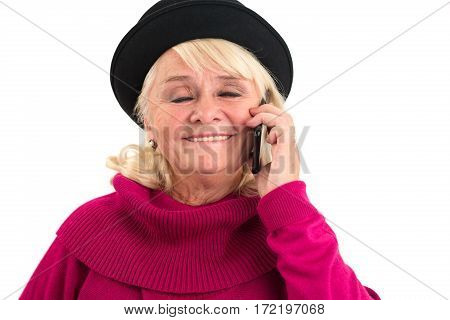 Smiling elderly female with cellphone. Woman with closed eyes isolated. Voice that makes me happy.