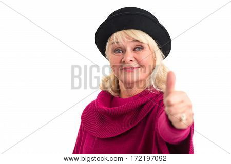 Senior lady showing thumbs up. Elderly female on white background.