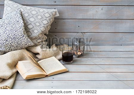 Cushions, Plaid, Lantern, Black Coffee And Old Book On The White Wooden Background, Closeup.