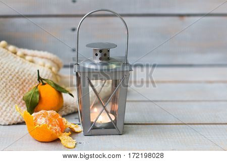 Christmas Still Life With Lantern, Plaid,  Tangerine And Red Beads On Wooden Background