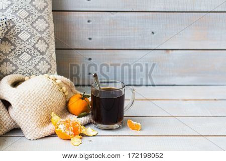 Aromatic Black Coffee And Tangerines On Light Wooden Background