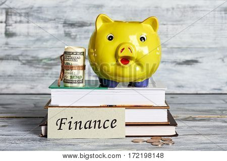 Money box on wooden surface. Finance and investment.