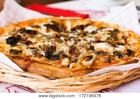 Delicious fresh hot pizza served on wooden table