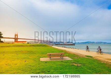 Golden Gate Bridge with fog from Crissy Field, San Francisco, California, United States. Crissy Field with scenic views is popular for locals and tourists. Leisure and recreational activities concept.