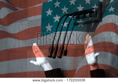 Hand of american politician in parliamentary debate United states flag background