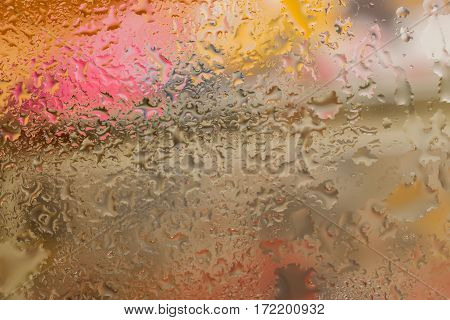 Abstract design element with real light reflection for banner, print, template, web, decoration. Modern background in warm tones with raindrops